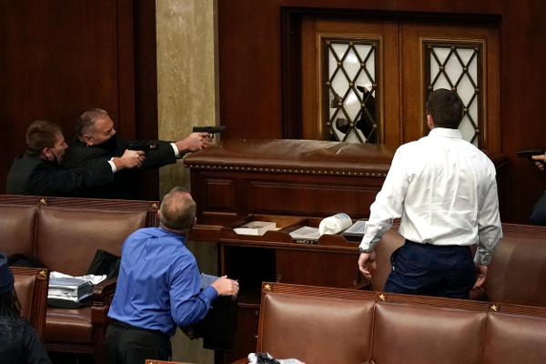 Police officers drew their guns inside the House chamber
