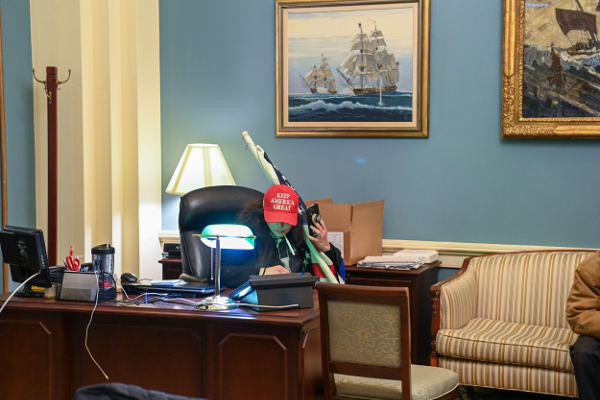 Woman sits at a desk in the offices inside the Capitol