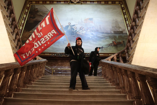 Trump supporter waves flag inside the Capitol