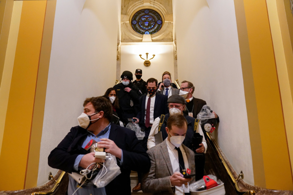 A group evacuates as a mob was entering the Capitol